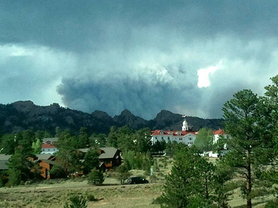 The smoke plume from the High Park Fire rising behind the Stanley Hotel. The High Park Fire continues to grow West of Fort Collins and resembles a volcano from Estes Park.