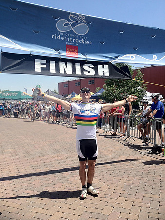 Walt Hester | Trail Gazette<br /> Sore, tired and elated to finish, the author celebrates with 2,000 other riders at the end of Ride the Rockies at the O'Dell Brewery in Fort Collins. In cycling, the rainbow stripes signify the world champion, and that is how a rider feels upon completing the six-day, 400-plus-mile ride across the Colorado Rockies.