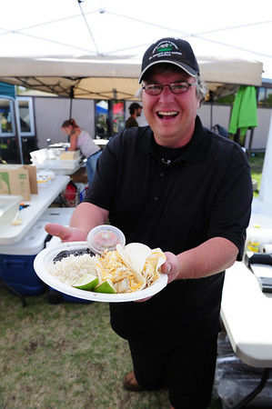 Walt Hester | Trail Gazette<br /> Scott Camp of High Altitude Cooking in Leadville, shows off his popular fish tacos at Lake County High School on Tuesday. While many vendors traveled with the Ride the Rockies group, some, like Camp, just showed up in their home towns.