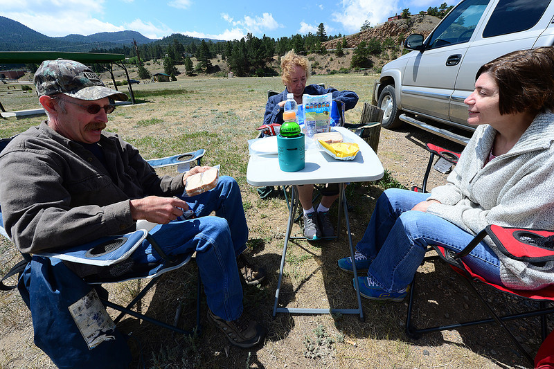 Walt Hester | Trail Gazette<br /> Jim and Eileen Wagner and Gail Caneva, all from Haxton, Colo. unpack a picnic at the Wapiti Meadow picnic area on Wednesday. Cooler temperatures made outdoor activities more comfortable ahead of expected return of heat this weekend.