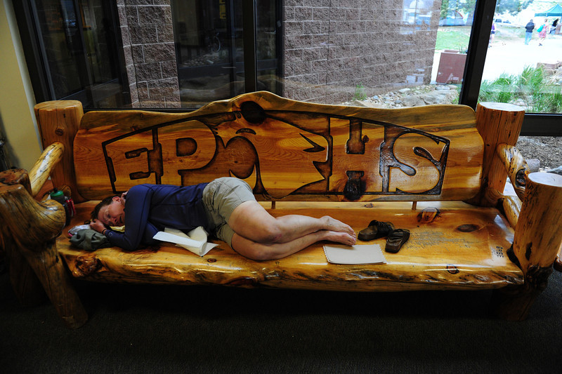 Walt Hester | Trail Gazette<br /> A worn-out Ride the Rockies cyclist catches a nap at Estes Park High School on Thursday. The school and the town hosted cyclists of the fifth of six days of riding that covered over 400 miles from Gunnison to Fort Collins.