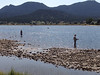 Fisherman try their luck near a sand bar off of the north shore in the upper end of Lake Estes.