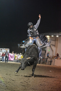 Walt Hester | Trail Gazette A bull rider entertains the big crowds at the Rooftop Rodeo in July. The rodeo enjoyed six nights of top-notch rodeo competition.
