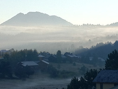 Fog drifts across the trees of Estes Park. A chilly morning is expected to give way to a warm and sunny day. Highs expected to reach to low 70s. The fog had burned off by the time the Scottish/Irish Highland Festival Parade started on Elkhorn Avenue at 9:30 a.m.
