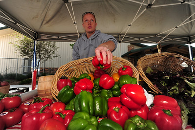 Walt Hester | Trail Gazette A vender arranges colorful peppers at the Estes Valley Farmers' Market. The market begins in June but runs every Thursday through the end of September.