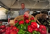 Walt Hester | Trail Gazette<br /> A vender arranges colorful peppers at the Estes Valley Farmers' Market. The market begins in June but runs every Thursday through the end of September.