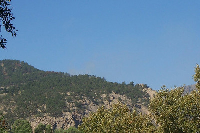 A thin wisp of smoke is barely visible from the Narrows Fire burning near the entrance to the Big Thompson Canyon following a couple of aircraft water drops Wednesday morning.