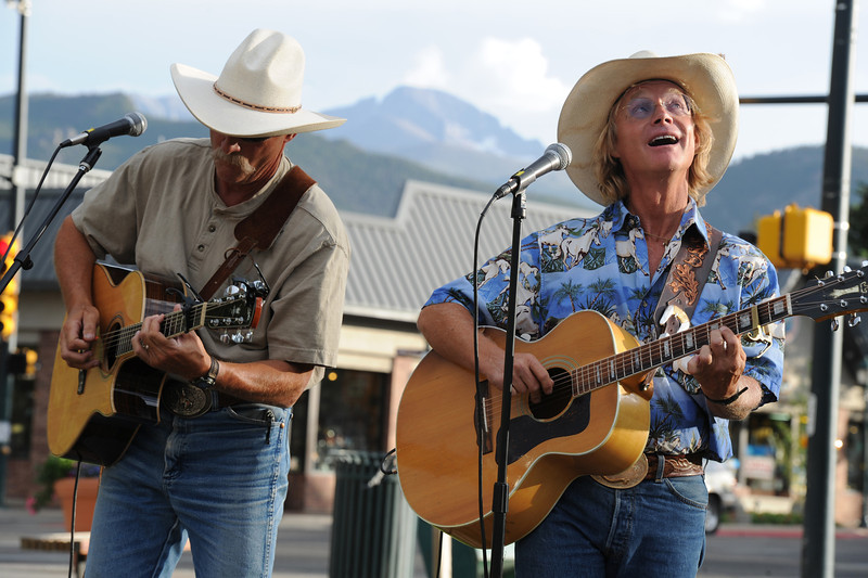 Walt Hester | Trail Gazette<br /> Cowboy Brad Fitch and Mark Rashid entertain fan at Bond Park. Cowboy Brad's cowboy sing-a-long has been entertaining visitors on summer evenings for more than a decade.