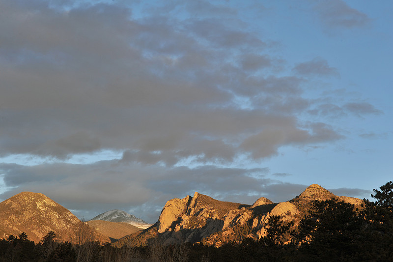 Wednesday's sunrise warms Lumpy Ridge and colors clouds early. Clouds would bring snow squalls later in the afternoon, the much of what accumulated in Estes Park melted off in 24 hours.
