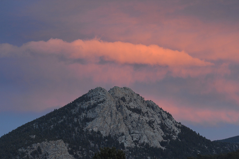 Pink clouds decorate the top of Mount Olympus on Tuesday. Clouds brought brief periods of snow on Wednesday, then cleared by Thursday morning.