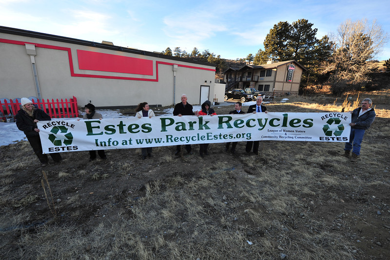 Members of Recycle Estes hold their new banner on display at Big Thompson and Wonderview avenues on Tuesday. The group holding the flag include Megan Lindeman, Diane Burkepile, Sue Magnuson, Jim Cope, Donald Holmes, Steve Faillaci and John Ericson.