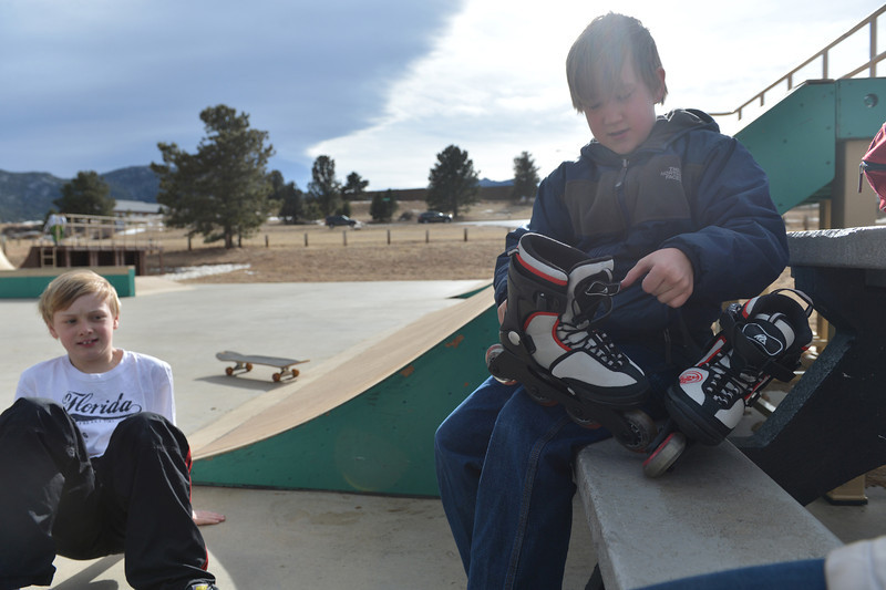 Elementary school students Cole Wallace, 9, and Logan Goodemote, 10, prpare for an afternoon of play at the Estes Valley Youth Center Skate Park on Wednesday. Elementary school students enjoyed a half-day off on Wednesday.