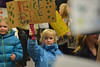 Chloe Coop holds a sign during the elementary school's annual Martin Luther King, Jr. Peace March on Friday. The march coincides with the celebration of Dr. King's birthday holiday.