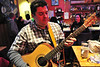 Denver musician Cris Zambrano warms up on a borrowed guitar at Ed's Cantina on Saturday night. Ed's Cantina hosts an open-mic night every Saturday night.