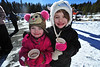 Chloe, 4, and Autumn Olson, 7, enjoy hot cocoa and fun hats at the annual Winter Trails Day in Rocky Mountain National Park on Saturday. Activities at the event included snowshoe demonstrations, igloo building and other family activities.