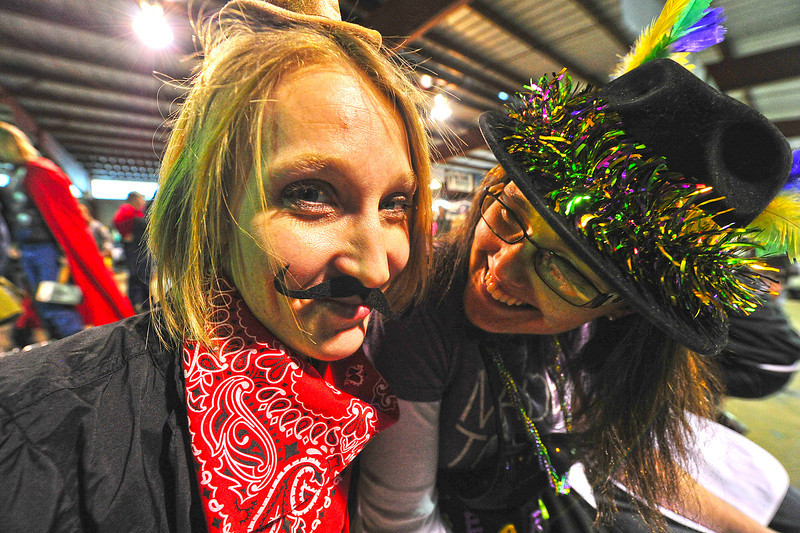 Michelle Hansen of Stage Coach, a chili contestant, and fellow contestant Joelene Hebart of the Cajun Bears, share a laugh on Sunday. Contestants came form all over the Front Range to claim the honor of best chili at the fourth annual Estes Park Winter Festival.