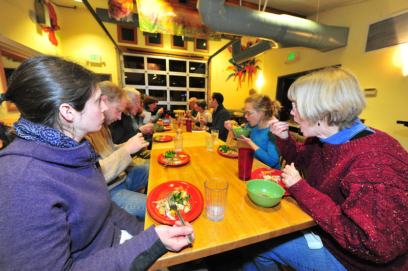 Paleo diet enthusiasts share dishes and companianship at Ed's Cantina on Friday night. Advocates point out Paleo is a lifestyle, a change in eating habits, not just a diet.
