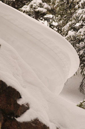 Walt Hester | Trail Gazette<br /> WInd-sculpted snow seems to display waves on a boulder in Rocky Mountain National Park on Wednesday.