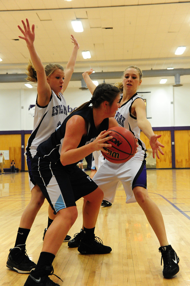 Walt Hester   Trail Gazette<br /> Karin Kingswood, left, and Morgan Morris trap a Platte Valley player last week. Kingswood swiped four steals against Eaton on Tuesday, leading the Ladycats in the catagory.