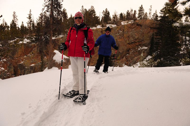 Walt Hester | Trail Gazette<br /> Joni and Peter Haughey tromp around in new snow along the Alberta Falls Trail on Wednesday.Snowshoing is a fun way to get out when weather is still cold.