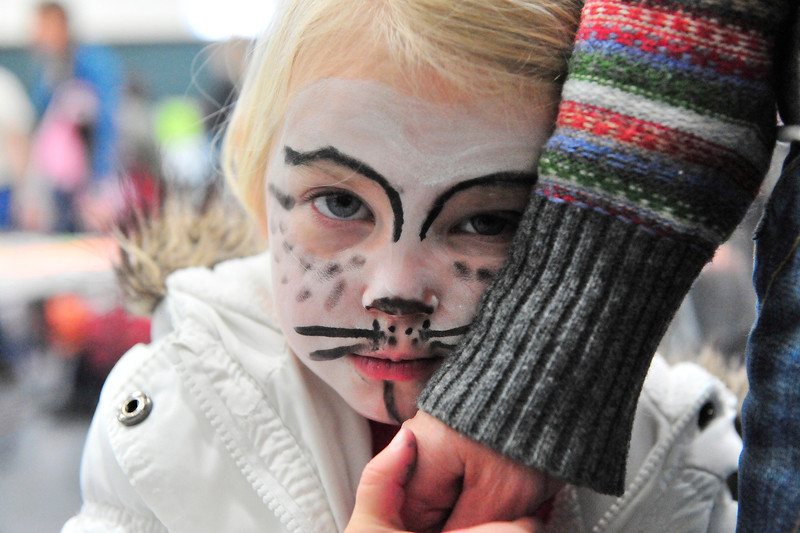 Walt Hester | Trail Gazette<br /> Hana Bolinder, 3, of Estes Park shyly displays her kitten face at Imagine This on Saturday. The annual event raises money for the Cultural Arts Council while exposing children to a wide variety of artistic expression.