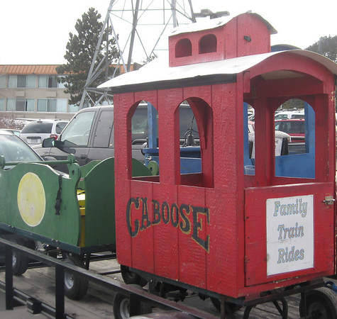 A Caboose waits in the parking lot of the Conference Center on Sunday, promoting the Rails in the Rockies model train show.