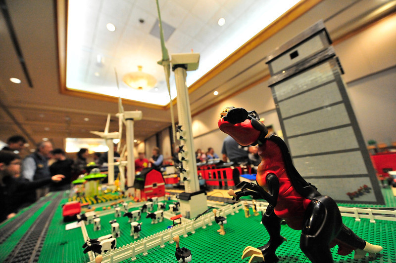 Walt Hester | Trail Gazette<br /> Farms of many varieties flank one side of the lego display. Cows, ostriches, corn and wind farms seem to be plagued by pre-historic monsters.