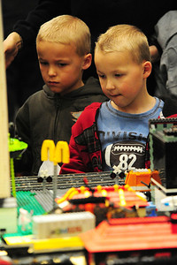 Walt Hester | Trail Gazette Twins Michael and Ryan Elsworth admire the lego train setup on Saturday. The lego land attracted fans of all ages.
