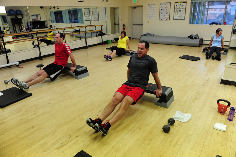 "Walt Hester | Trail Gazette<br /> Participants in Rocky Mountain Health Club's ""Spartacus"" class suffer through an early-morning workout. The class, like many recently, is high-intensty and varied from class to class, attracting people looking for something new."