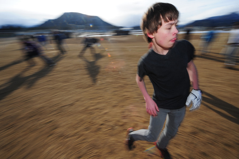 Walt Hester   Trail Gazette<br /> Tyler Dill, 15, shuffles through drills for baseball on Wednesday. Practice for spring sports started this week, though spring weather could be weeks away.