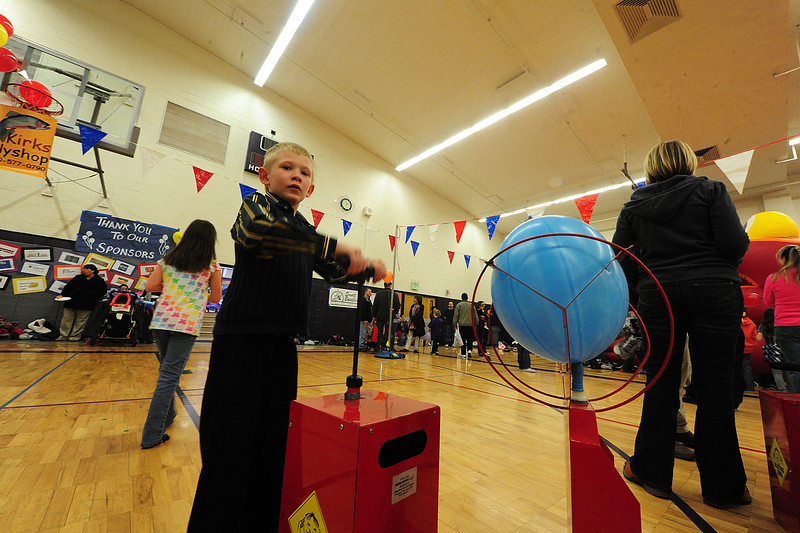 Walt Hester | Trail Gazette<br /> Allen Diunn, 6, inflates a balloon to the point of exploding at the carnival. Bouncing, twisting, dancing, creating and exploding were all activities offered at the Winter Carnival.