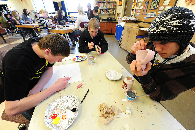 Walt Hester | Trail Gazette<br /> Austin Severin, 17, Caleb Weber, 16 and Ian McLain work on different art projects in their art class on Wednesday. Many of the students worked on a wide range of projects like drawing, painting ceramics and other 3D art.