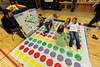 Walt Hester | Trail Gazette<br /> Children flop around on a home-made Twister game at the annual Winter Carnival on Sunday. The event was planned to be fun for all ages.