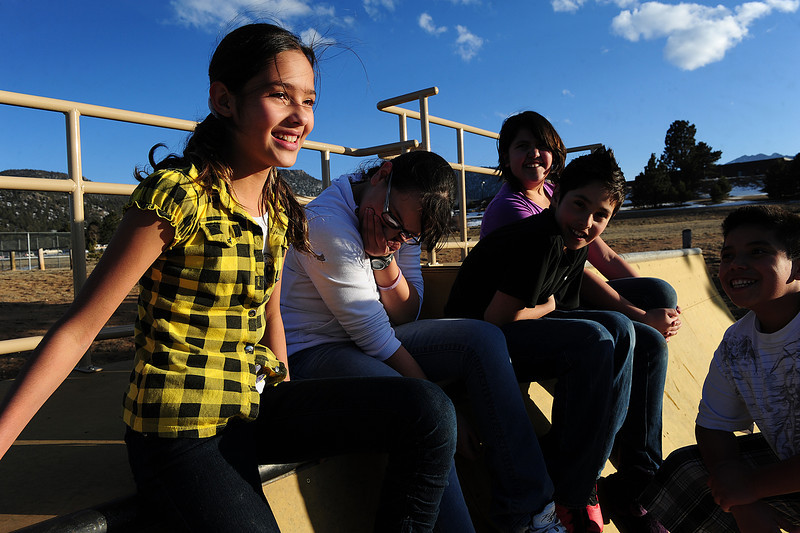 Walt Hester | Trail Gazette<br /> Teasing and giggling are the order of the day for Alex Marquez 11, Paola Regalado,12, Roberto Luna, 12, Marely Avitia, 11 and Yael Acosta. The children were anjoying the relatively nice weather ahead of the colder, mid-week temperatures.