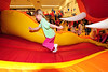 Walt Hester | Trail Gazette<br /> Children run through the main attraction on Sunday, a huge, inflated, bouncy dragon. The theme of this year's carnival was the Year of the Dragon, as it is on the Chinese calendar.