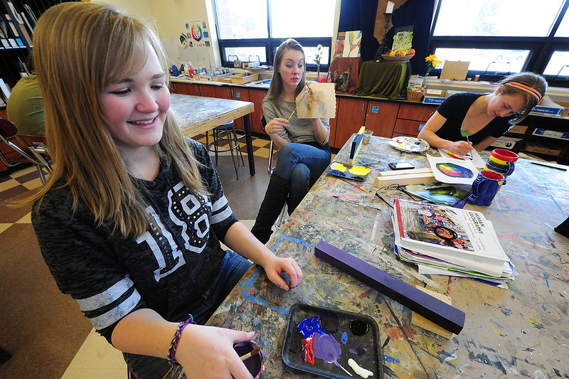 Walt Hester | Trail Gazette<br /> Jackie Maeurman, 16, Emma Reins, 15, and Loral Todd work on projects in their art class on Wednesday. While each student was paining, each had a very different project.