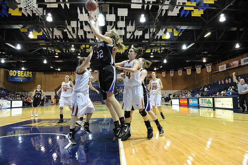 Walt Hester | Trail Gazette<br /> Ladycat Evelyn Bangs shoots in the second half against the Mead Mavericks. Bangs led the Estes Park girls with 13 points in a defensive battle.