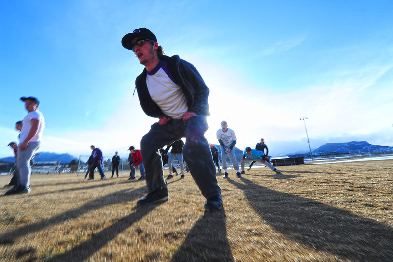 Walt Hester | Trail Gazette<br /> David Klein and fellow seniors lead warm ups for the baseball team on Wednesday. The baseball season is notoriously difficult in Estes Park as snow can fall and postpone games all the way into late May.