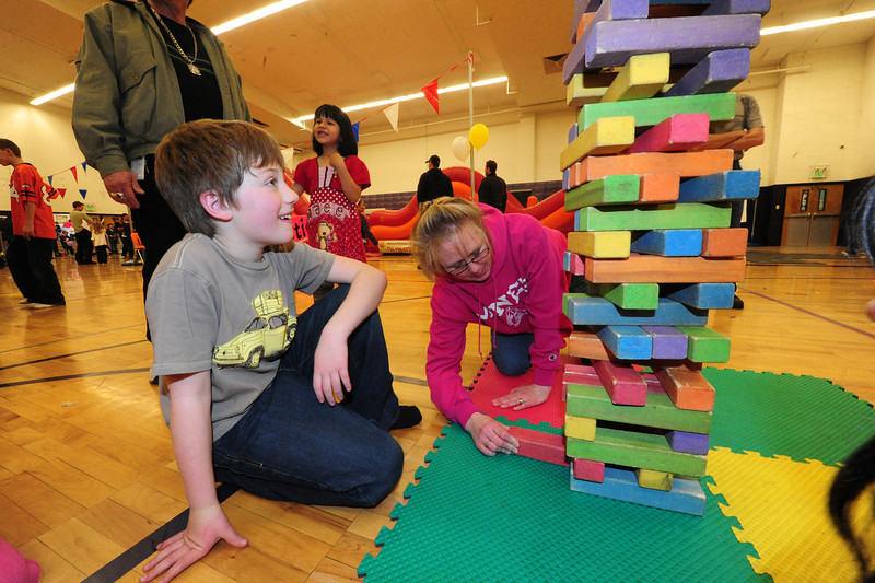Walt Hester | Trail Gazette<br /> Aidyn Scott, 10, left, plays a giant version of Jenga at the Winter Carnival.