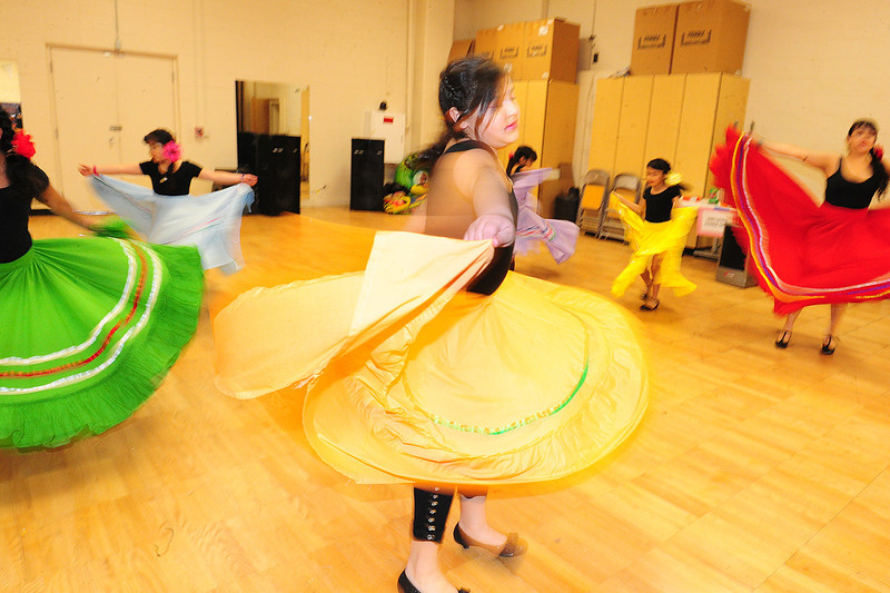 Walt Hester | Trail Gazette<br /> Young performers, such as Jennifer Salinas, 10, swirl skirts during a Mexican folk dance demonstration during the Winter Carnival. Even the carnival is a chance to learn about dance and culture at the schools.