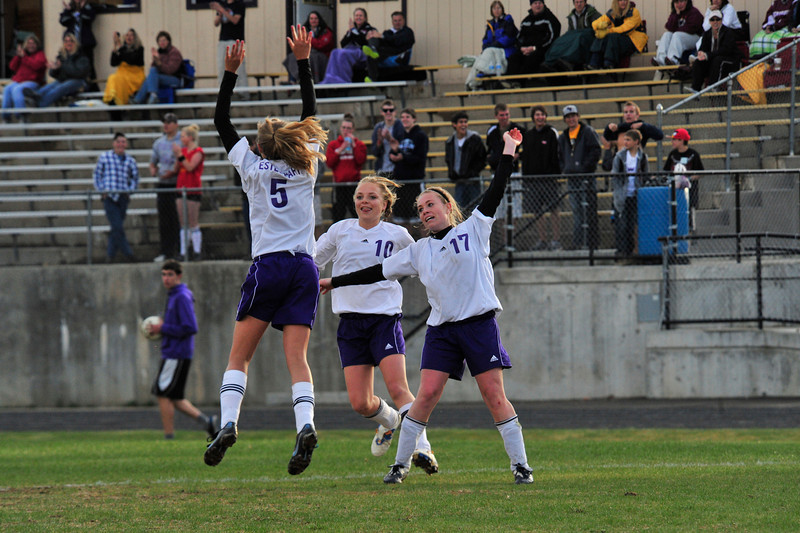 Walt Hester | Trail Gazette<br /> Ladycats Karin Kingswood (#5), Maddy Paul (10) and Shelby Kufeld (17) celebrate Kingswood's insurance goal agains the visiting Berthoud on Wednesday. Kufeld scored the Estes Park girls' first goal in the 2-0 win, the 'Cats' third straight.