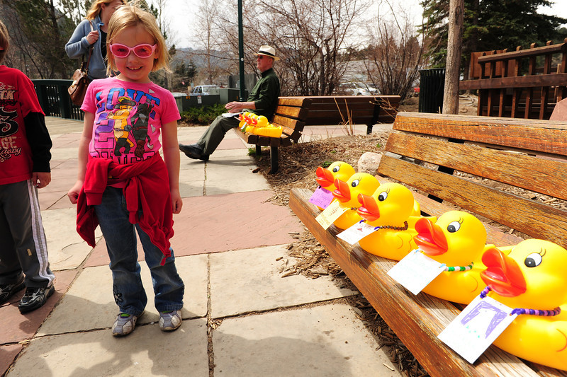 Walt Hester | Trail Gazette<br /> Alison Raymond, 5, enjoys the big sponsor ducks at Riverside Plaza on Wednesday. May's Duck Race is not only a fund raising event, but a family-friendly, moving party.