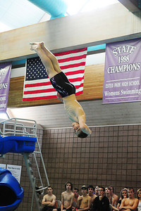 Walt Hester | Trail Gazette Senior diver Will Casey completes a complicated dive during Thursday's meet. Both Casey and junior Nate Dewitt have the degrees of difficulty in dives to qualify for the state meet, they now have to bring up their scores in those dives.