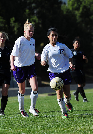 Walt Hester | Trail Gazette<br /> Jenna Wahler, left, and Miranda Ruiz hodl down the midfield for the Ladycats against the visiting Valley Vikings on Friday. Both girls not only defended well, but got the ball upfield for goal, earning both girls assists in the 2-0 Estes Park win.