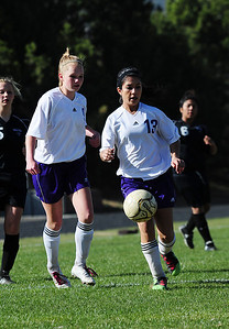 Walt Hester | Trail Gazette Jenna Wahler, left, and Miranda Ruiz hodl down the midfield for the Ladycats against the visiting Valley Vikings on Friday. Both girls not only defended well, but got the ball upfield for goal, earning both girls assists in the 2-0 Estes Park win.