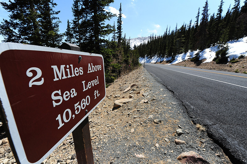 Walt Hester | Trail Gazette<br /> A sign along Trail Ridge Road anounces the altitude for visitors. A year ago, the sign was not visible, it was burried in snow.