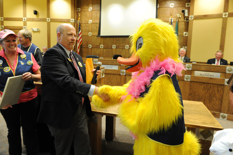 Walt Hester | Trail Gazette<br /> Mayor Pro Tem Chuck Lavineshakes hands with Quilton T. Canvasback after recognizing the good work of the Rotary Club and the Estes Park Duck Race at Tuesday's town council meeting. The Duck Race will be on Saturday, May 5.