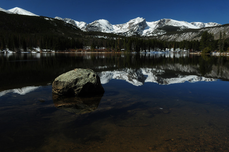 Walt Hester | Trail Gazette<br /> Snow covers the peaks above and the shore around Sprague Lake on Wednesday. Temperatures are not cold enough to reform much ice on the lake.