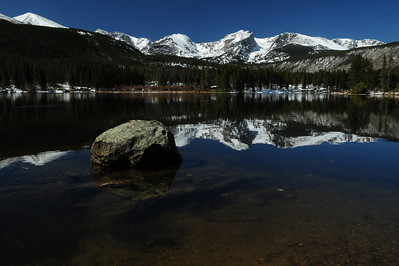 Walt Hester | Trail Gazette Snow covers the peaks above and the shore around Sprague Lake on Wednesday. Temperatures are not cold enough to reform much ice on the lake.