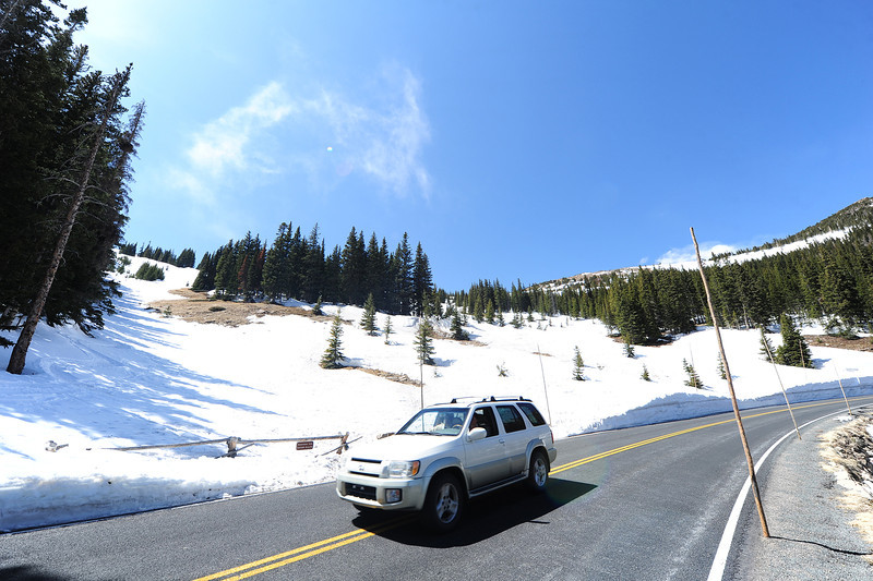 Walt Hester | Trail Gazette<br /> A visitor drives around the curve under the upper bowl of Hidden Valley on Monday. Last year, drivers could not get this view both because the gates were closed and crews were still working on the roadand the snow was much higher on the road's edges.